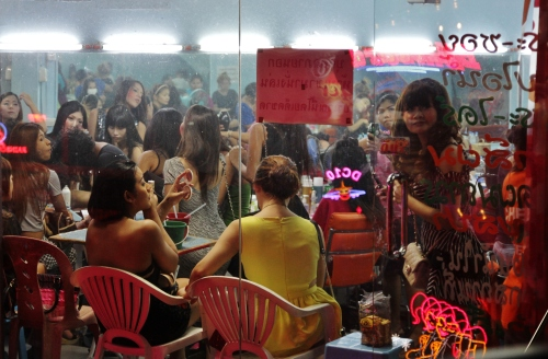 Women crowded into a 'beauty room' and watched like animals in a zoo