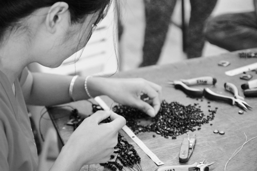 A rescue girl working in the Destiny Rescue jewellery room